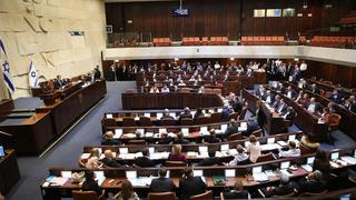 MKs in the Knesset as parliament dissolved itself on Wednesday