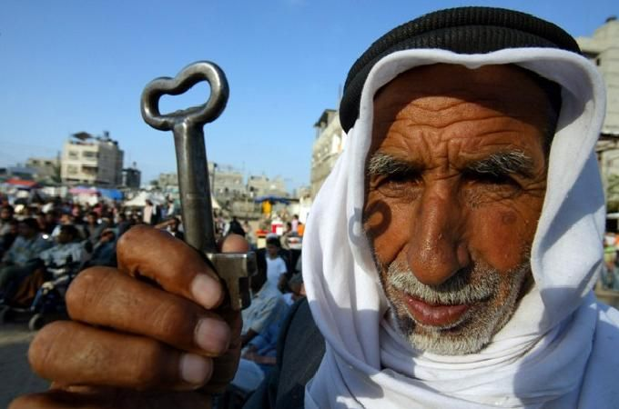 A Palestinian refugee in Lebanon holding the key to his former house in Israel