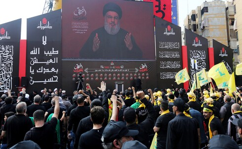Hezbollah leader, Hassan Nasrallah, giving a speech in Labnon's capital city of Beirut