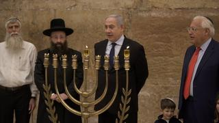 Prime Minister Benjamin Netanyahu (center) and United States Ambassador to Israel David Friedman lighting the first candle of Hanukkah at the Western Wall in Jerusalem
