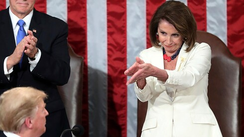 President Donald Trump turns to House Speaker Nancy Pelosi, as he delivers his State of the Union address to a joint session of Congress on Capitol Hill in Washington, as Vice President Mike Pence watches