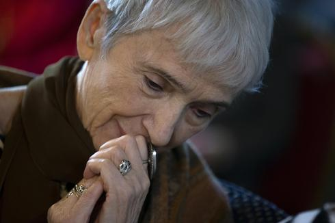 A woman listens to Holocaust survivor Mikhail Spectr in Moscow