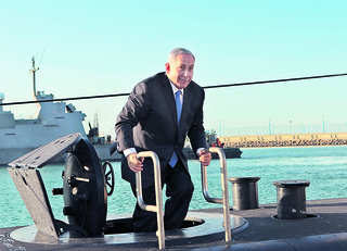 Prime Minister Benjamin Netanyahu touring the INS Tanin submarine, built by the German firm Thyssenkrupp, as it arrived in Israel