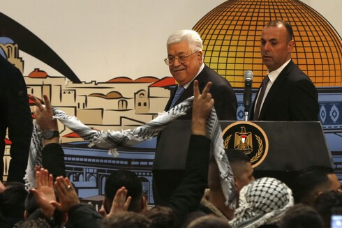 Palestinian President Mahmoud Abbas attends a ceremony marking the 55th foundation anniversary of the Fatah movement in the West Bank city of Ramallah. Dec. 31, 2019