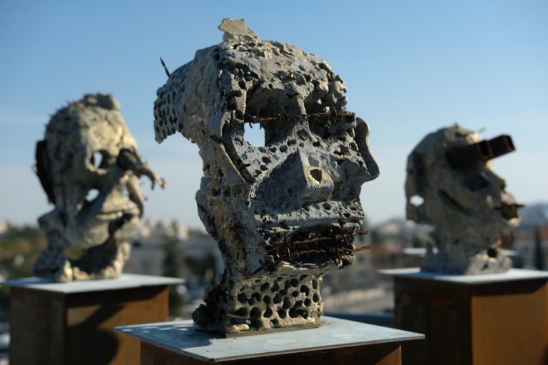 A view of some of the brass heads on display in Reuven Hasak's exhibition at the Museum on the Seam in Jerusalem