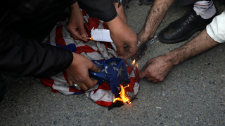 U.S. flag being set on fire in Iran
