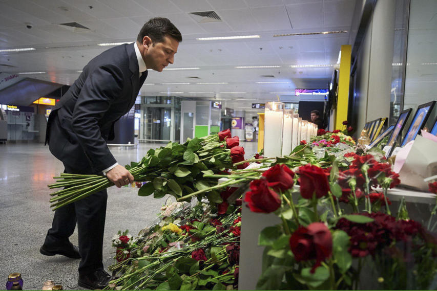 Ukrainian President Volodymyr Zelensky lays flowers in memory of passangers and crew of downed airliner