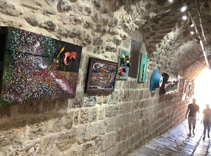 An alleyway turned into an art gallery in old Akko