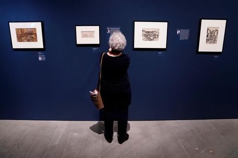 """People attend the preview of """"Rendering Witness"""" exhibition at the Museum of Jewish Heritage"""