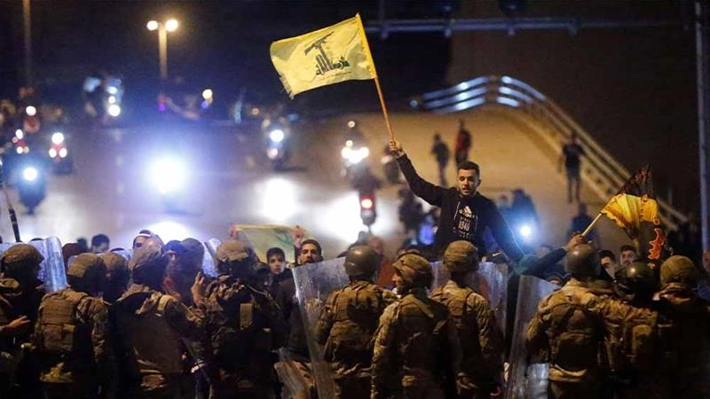 Hezbollah and Amal demonstrators clashing with police in Beirut