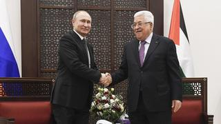Vladimir Putin meets with Palestinian President Mahmoud Abbas in Ramallah during the Russian leader's visit to Israel on Thursday