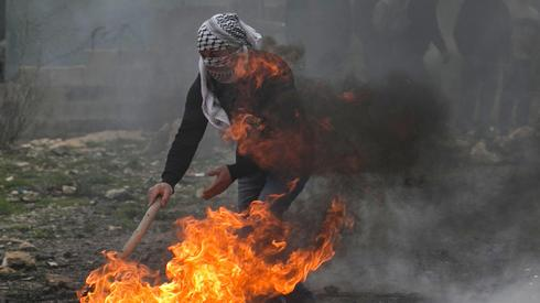 Palestinian protesting in the West Bank