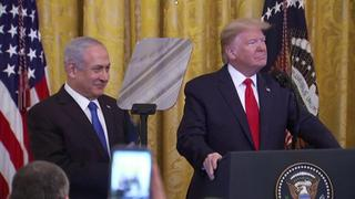Prime Minister Benjamin Netanyahu watches as President Donald Trump unveils his peace plan