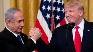 Prime Minister Benjamin Netanyahu and U.S. President Donald Trump clasp hands during the White House announcement on its Mideast peace plan, January 2020