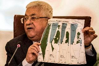 Palestinian President Mahmoud Abbas reacts to the U.S. peace plan at a special meeting of teh Arab League in Cairo, Feb. 1, 2020