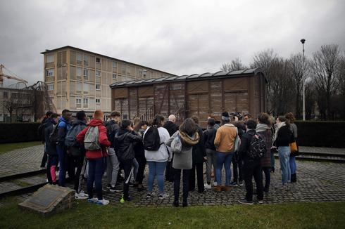 Students attend a workshop dedicated to the Holocaust remembrance at the Drancy Shoah memorial, outside Paris, Jan. 30, 2020