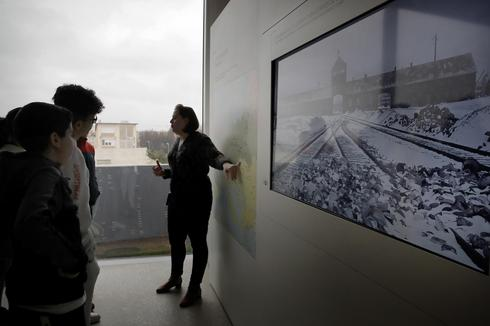 Students listen to guide Alix Quere at a workshop dedicated to Holocaust remembrance at the Drancy Shoah memorial, outside Paris, Jan. 30, 2020