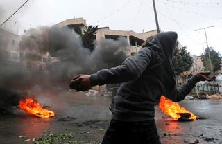 Palestinian rioter in the West Bank