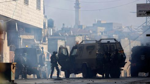 Israeli troops clash with Palestinian demonstrators on the West Bank