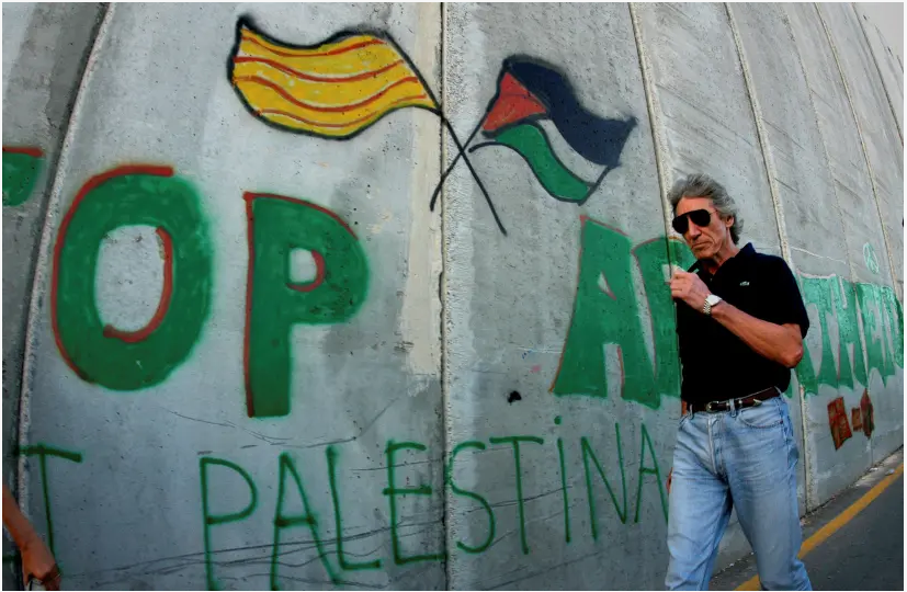 Roger Waters walks along the Israeli barrier in the Palestinian city of Bethlehem