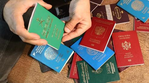 A Kurdish official shows the passports of captured foreign Islamic State fighters