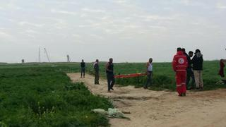 Palestinians at the scene of the incident along the Gaza fence