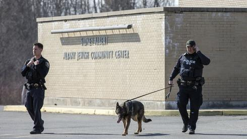 Police officers outside the Albany JCC following a bomb threat