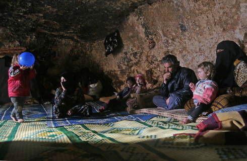Syrian refugees in Idlib hiding from the fighting in an underground cave