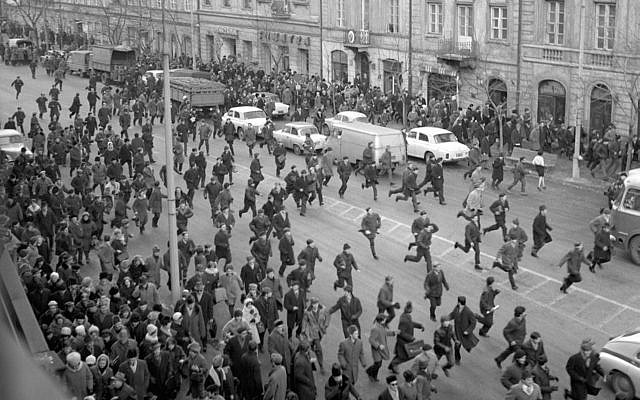A March 1968 black and white photo showing people running away as police attack near the Warsaw University during student riots. The 1968 student riots in Poland ended with an anti-Semitic campaign by the communist regime that drove an estimated 15,000 Jews from Poland