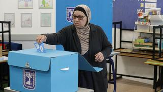 A woman votes in the Arab town of Tamra, March 2, 2020