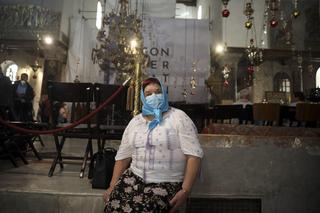 A visitor wears a mask at the Church of the Nativity in Bethlehem after a suspected coronavirus outbreak in the city earlier this month