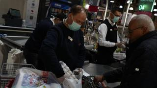 Gazans in a supermarket wearing protective masks