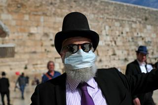 A man wearing a mask at the Western Wall