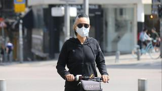 A woman wearing surgical mask in Tel Aviv