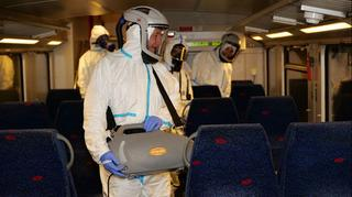 Health workers disinfecting an Israel Railways train
