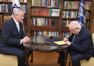 President Reuven Rivlin signs the mandate for Benny Gantz to form the government