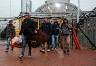 Palestinian laborers passing into Israel through a checkpoint in the West Bank city of Hebron