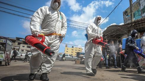 Gaza officials disinfect the streets of the Strip