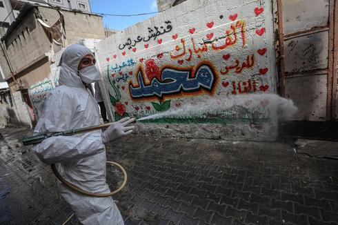 Gaza health worker spraying disinfectant in the streets amid coronavirus outbreak