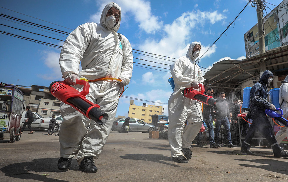 Gaza health workers disinfecting the streets