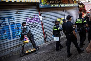 Police enforce the closure at Tel Aviv's famed Carmel Market