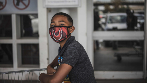 A South African boy wears a face mask against coronavirus in Johannesburg, March 2020