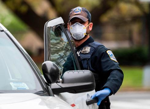 Police officer wearing a protective face mask
