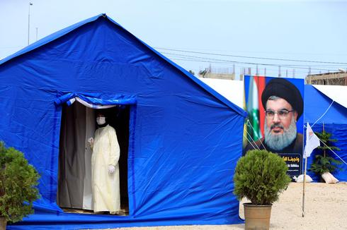 Makeshift hospital for coronavirus patients, Nasrallah's portrait on the left