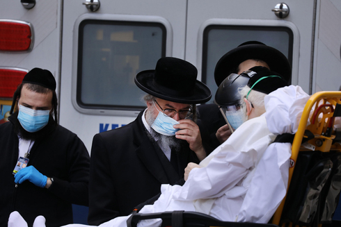 An elderly Haredi man afflicted with COVID-19 is taken to Mount Sinai Hospital in New York