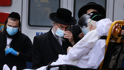 An elderly Haredi man afflicted with COVID-19 is brought to Mount Sinai Hospital in New York