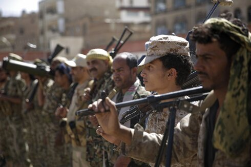 Houthi rebel fighters display their weapons during a gathering aimed at mobilizing more fighters for the Iranian-backed Houthi movement, in Sanaa, Yemen.
