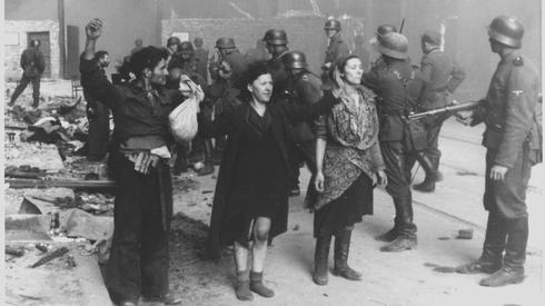 Nazi troops capture members of the Warsaw Ghetto resistance,  1943