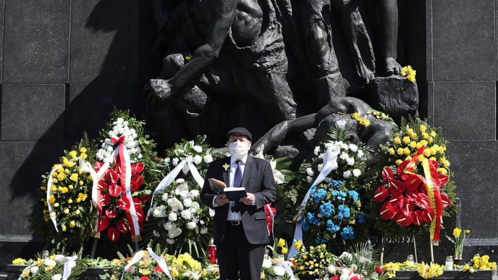 Polish Chief Rabbi Michael Schudrich says prayers before the monument to the heroes of the 1943 Warsaw Ghetto Uprising