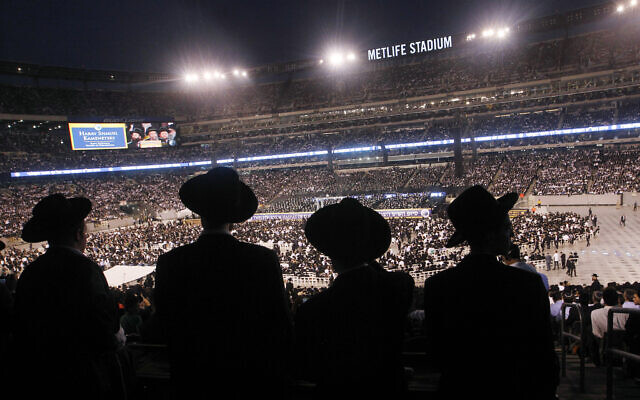 A large crowd of Orthodox Jewish men stand at MetLife stadium in East Rutherford, New Jersey, during the celebration of Siyum HaShas